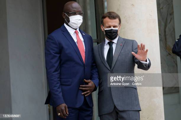 French President Emmanuel Macron welcomes Liberia's President George Weah at Elysee Palace on July 1, 2021 in Paris, France.