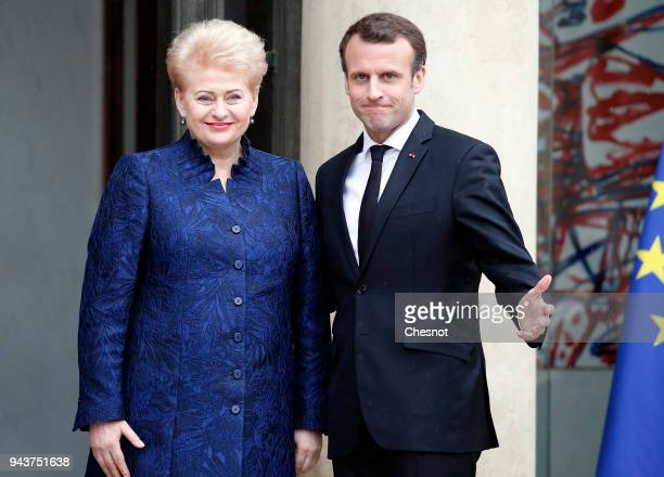 French President Emmanuel Macron welcomes Lituania President Dalia Grybauskaite prior to their meeting at the Elysee Presidential Palace on April 09,...