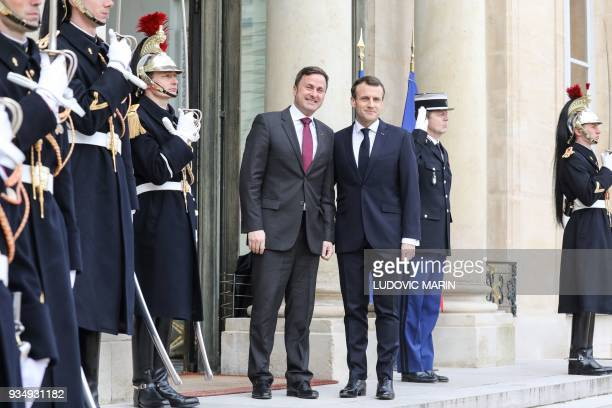 French president Emmanuel Macron welcomes Luxembourg Prime Minister Xavier Bettel upon his arrival at the Elysee presidential palace prior to their...