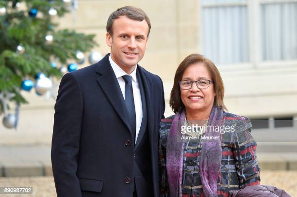 French President Emmanuel Macron welcomes Marshall Islands President Hilda Heine as she arrives for a meeting for the One Planet Summit's...