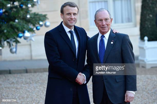 French President Emmanuel Macron welcomes Michael Bloomberg as he arrives for a meeting for the One Planet Summit's international leaders at Elysee...