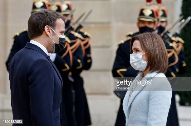 French President Emmanuel Macron welcomes Moldovan President Maia Sandu prior to a working lunch during an official visit at the Elysee Palace on...