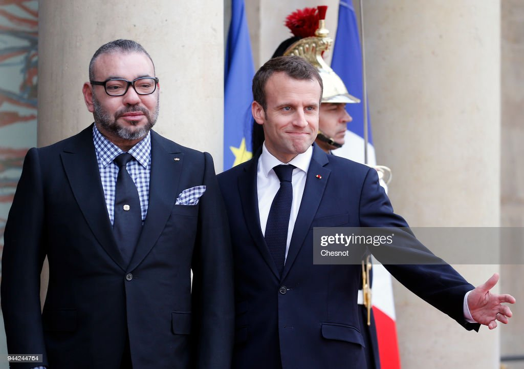 French President Emmanuel Macron welcomes Morocco's King Mohammed VI prior to their meeting at the Elysee Presidential Palace on April 10, 2018 in Paris, France. King Mohammed VI is in Paris for an official visit.
