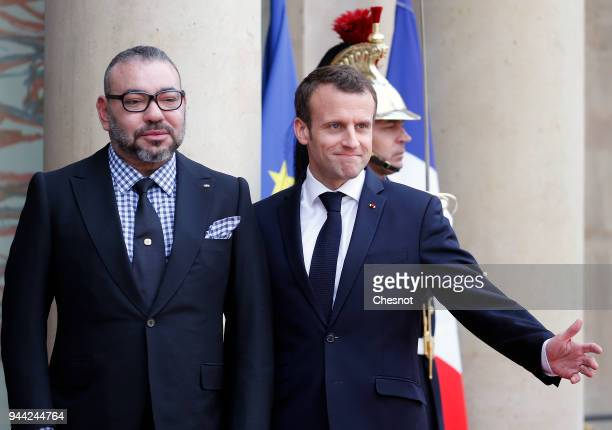 French President Emmanuel Macron welcomes Morocco's King Mohammed VI prior to their meeting at the Elysee Presidential Palace on April 10 2018 in...