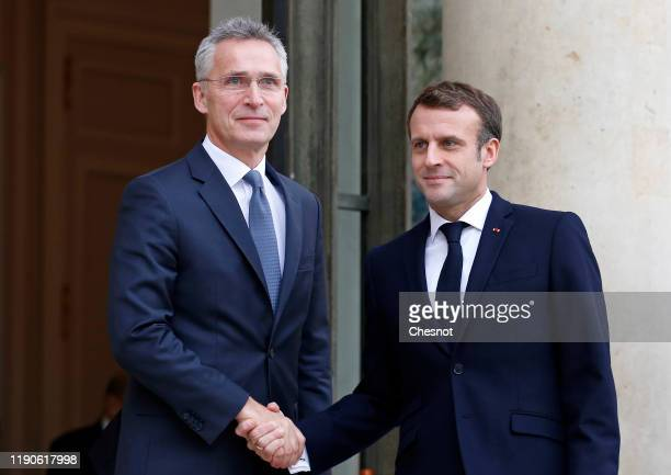 French President Emmanuel Macron welcomes NATO Secretary General Jens Stoltenberg prior to their meeting at the Elysee Presidential Palace on...