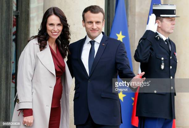 French President Emmanuel Macron welcomes New Zealand's Prime Minister Jacinda Ardern prior to their meeting at the Elysee Palace on April 16 2018 in...