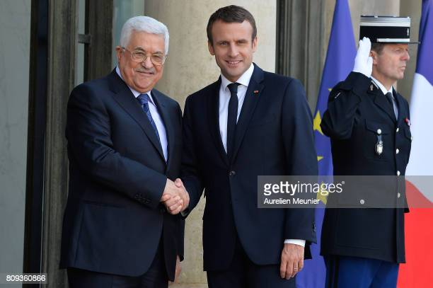 French President Emmanuel Macron welcomes Palestinian President Mahmoud Abbas for a meeting at Elysee Palace on July 5 2017 in Paris France...