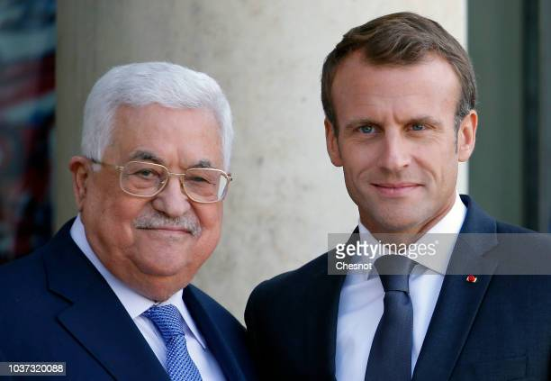 French President Emmanuel Macron waits for Palestinian President Mahmoud Abbas prior to their meeting at the Elysee Presidential Palace on September...