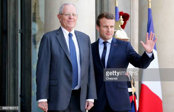 French President Emmanuel Macron welcomes Peruvian President Pedro Pablo Kuczynski prior their meeting at the Elysee Presidential Palace on June 08...