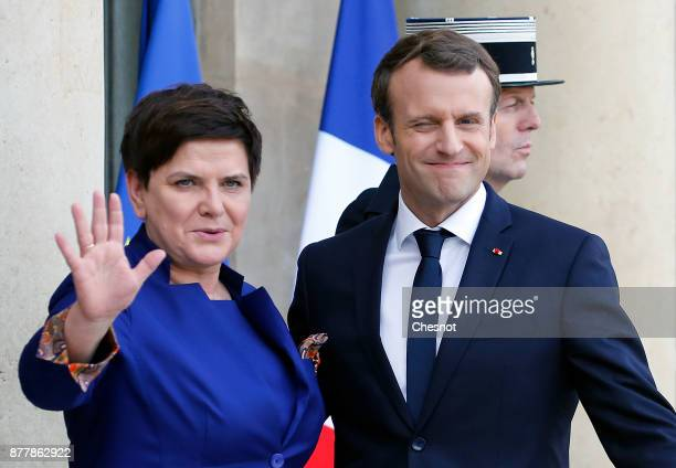 French President Emmanuel Macron welcomes Polish Prime Minister Beata Szydlo prior to their meeting at the Elysee Presidential Palace on November 23...