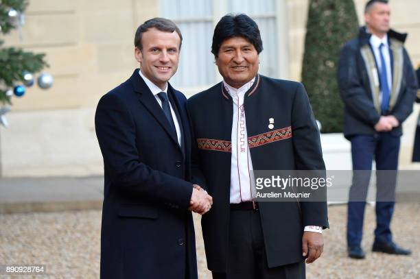 French President Emmanuel Macron welcomes President of Bolivia Evo Morales as he arrives for a meeting for the One Planet Summit's international...