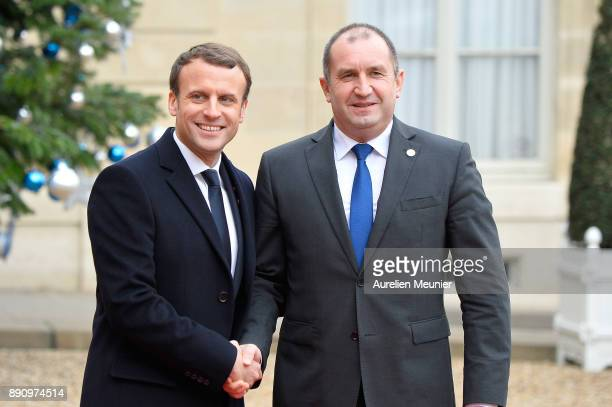 French President Emmanuel Macron welcomes President of Bulgaria Rumen Radev as he arrives for a meeting for the One Planet Summit's international...