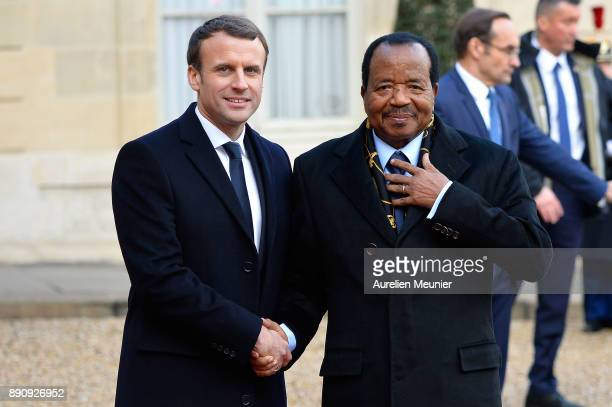 French President Emmanuel Macron welcomes President of Cameroon, Paul Biya as he arrives for a meeting for the One Planet Summit's international...