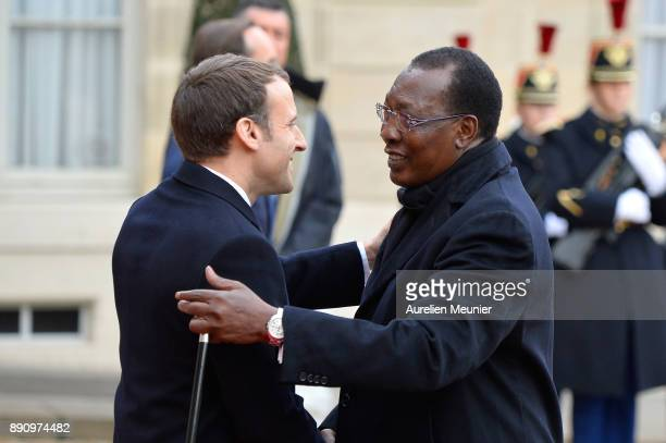 French President Emmanuel Macron welcomes President of Chad Idriss Deby as he arrives for a meeting for the One Planet Summit's international leaders...