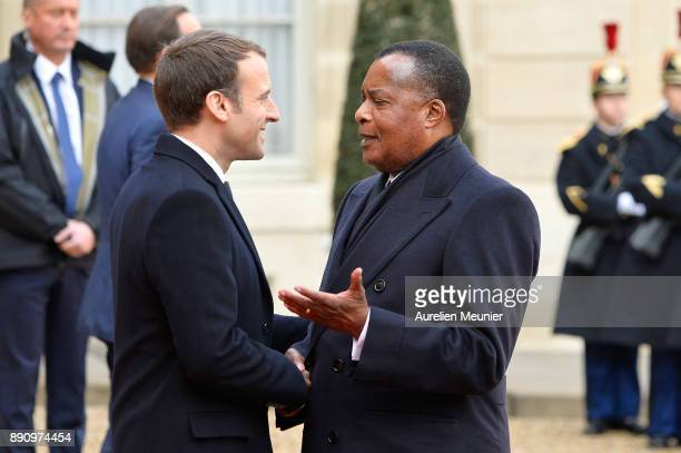 French President Emmanuel Macron welcomes President of Congo Denis Sassou Nguesso as he arrives for a meeting for the One Planet Summit's...