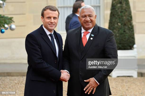 French President Emmanuel Macron welcomes President of Fiji Frank Bainimarama as he arrives for a meeting for the One Planet Summit's international...