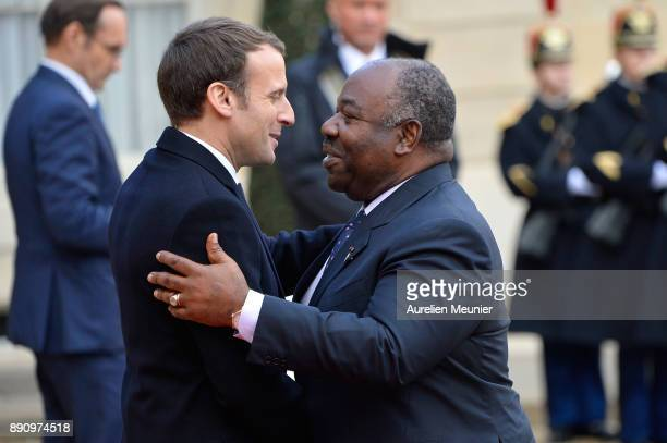French President Emmanuel Macron welcomes President of Gabon Ali Bongo Ondimba as he arrives for a meeting for the One Planet Summit's international...
