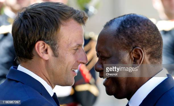 French President Emmanuel Macron welcomes President of Ivory Coast Alassane Ouattara prior to their meeting at the Elysee Presidential Palace on July...