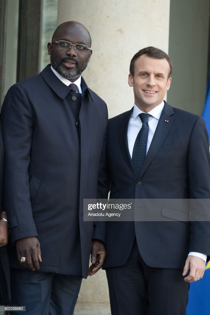French President Emmanuel Macron (R) welcomes President of Liberia, George Weah (L) at Elysee Palace in Paris, France on February 21, 2018.