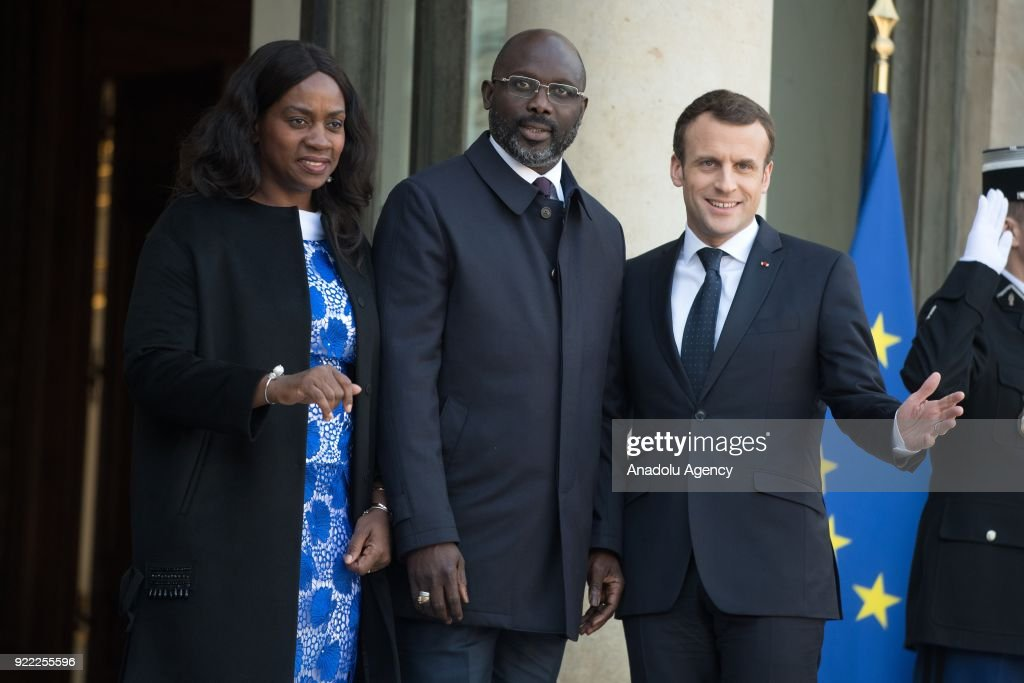 French President Emmanuel Macron (R) welcomes President of Liberia, George Weah (C) and his wife Clar (L) at Elysee Palace in Paris, France on February 21, 2018.