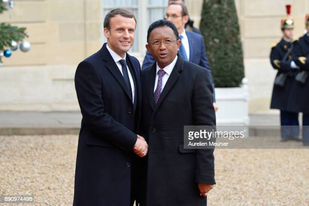 French President Emmanuel Macron welcomes President of Madagascar Hery Rajaonarimampianina as he arrives for a meeting for the One Planet Summit's...