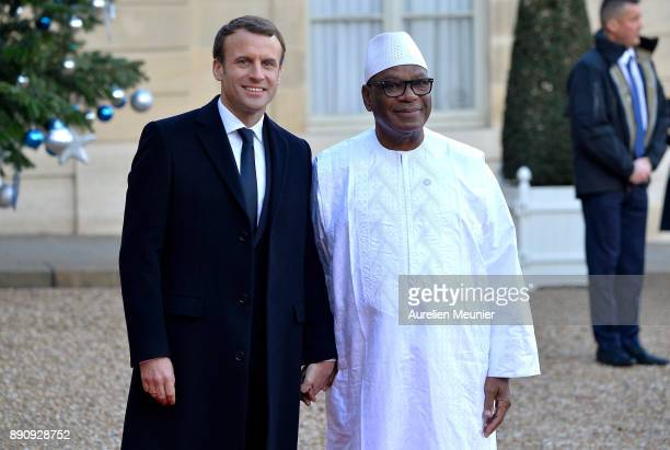French President Emmanuel Macron welcomes President of Mali Ibrahim Boubacar Keita as he arrives for a meeting for the One Planet Summit's...