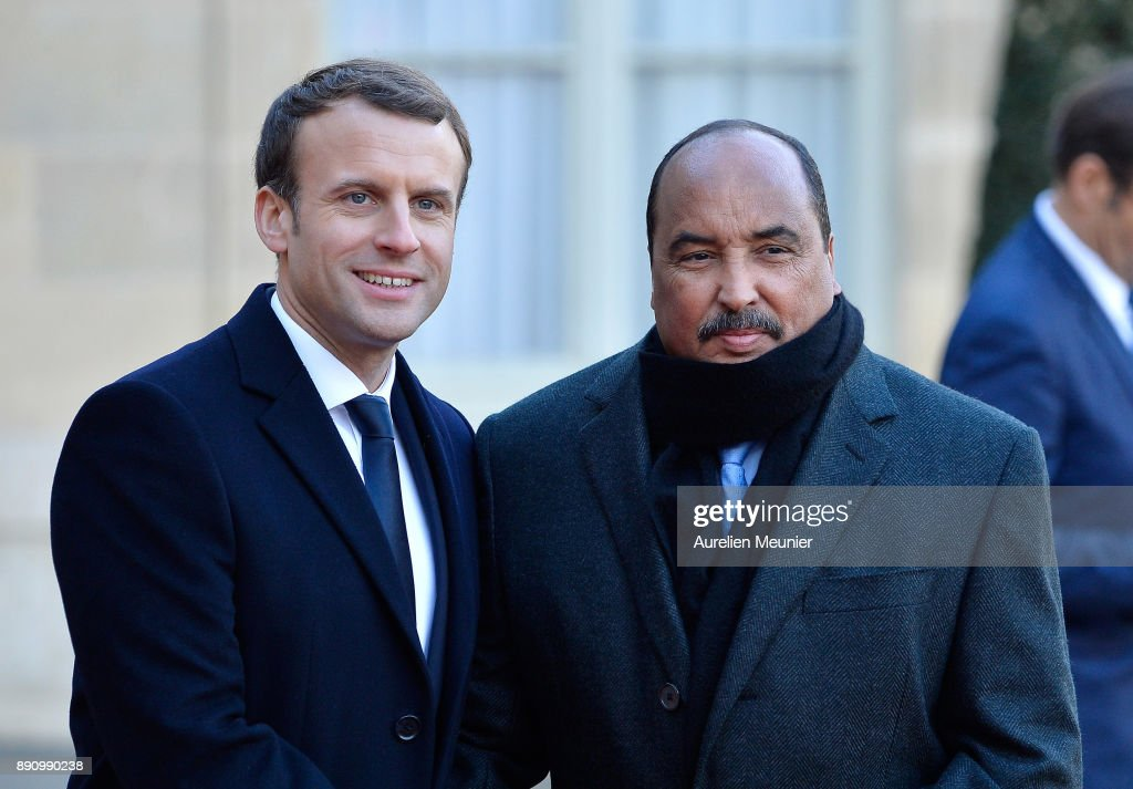 French President Emmanuel Macron welcomes President of Mauritania Mohamed Ould Abdel Aziz as he arrives for a meeting for the One Planet Summit's international leaders at Elysee Palace on December 12, 2017 in Paris, France. Macron is hosting the One Planet climat summit, which gathers world leaders, philantropists and other committed private individuals to discuss climate change.