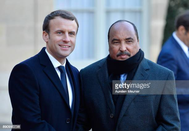 French President Emmanuel Macron welcomes President of Mauritania Mohamed Ould Abdel Aziz as he arrives for a meeting for the One Planet Summit's...