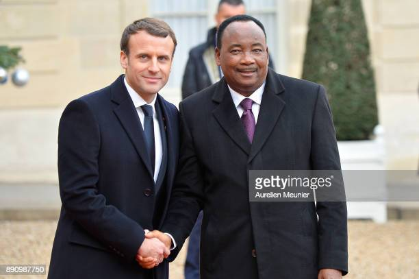 French President Emmanuel Macron welcomes President of Niger Mahamadou Issoufou as he arrives for a meeting for the One Planet Summit's international...