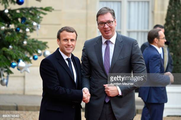 French President Emmanuel Macron welcomes President of Serbia Aleksandar Vucic as he arrives for a meeting for the One Planet Summit's international...