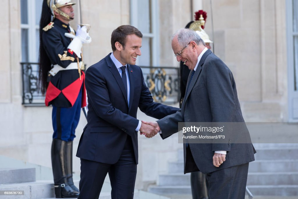 French President Emmanuel Macron (L) welcomes President of the Republic of Peru Pedro Pablo Kuczynski (R) for a meeting at the Elysee Palace on June 8, 2017 in Paris, France.