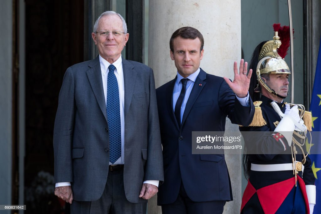 French President Emmanuel Macron (R) welcomes President of the Republic of Peru Pedro Pablo Kuczynski (L) for a meeting at the Elysee Palace on June 8, 2017 in Paris, France.