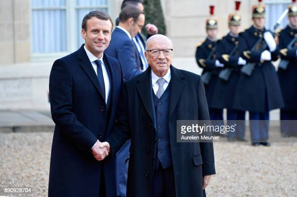 French President Emmanuel Macron welcomes President of Tunisia Beji Caid Essebsi as he arrives for a meeting for the One Planet Summit's...