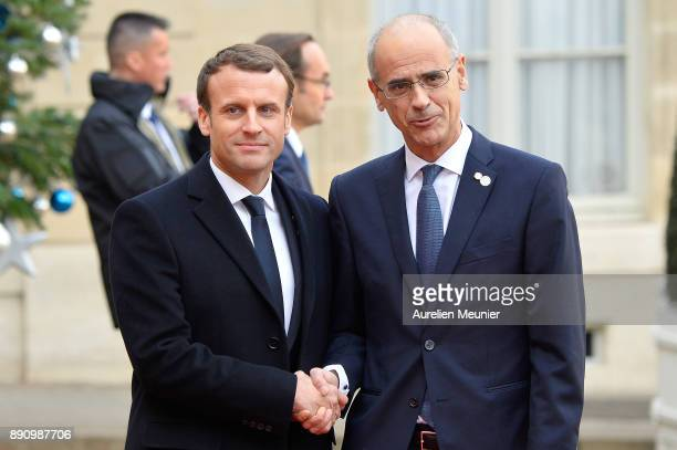 French President Emmanuel Macron welcomes Prime Minister of Andorra Antoni Marti as he arrives for a meeting for the One Planet Summit's...