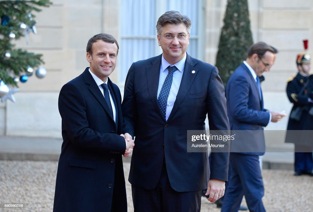 French President Emmanuel Macron welcomes Prime Minister of Croatia Andrej Plenkovic as he arrives for a meeting for the One Planet Summit's international leaders at Elysee Palace on December 12, 2017 in Paris, France. Macron is hosting the One Planet climat summit, which gathers world leaders, philantropists and other committed private individuals to discuss climate change.