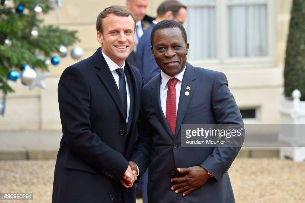 French President Emmanuel Macron welcomes Prime Minister of Grenada Keith Mitchell as he arrives for a meeting for the One Planet Summit's...