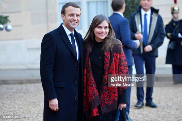 French President Emmanuel Macron welcomes Prime Minister of Iceland Katrin Jakobsdottir as she arrives for a meeting for the One Planet Summit's...