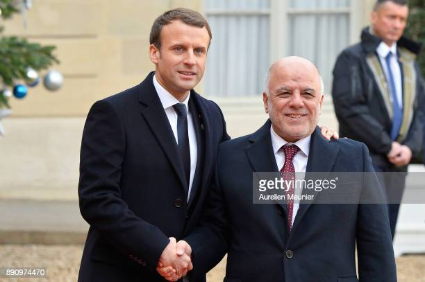 French President Emmanuel Macron welcomes Prime Minister of Irak Haider alAbadi as he arrives for a meeting for the One Planet Summit's international...