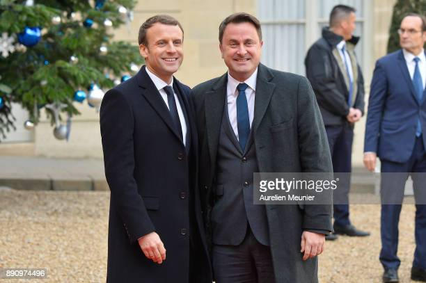 French President Emmanuel Macron welcomes Prime Minister of Luxembourg Xavier Bettel as he arrives for a meeting for the One Planet Summit's...