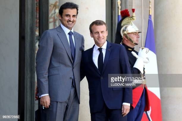 French president Emmanuel Macron welcomes Qatar Sheikh Tamim bin Hamad Al Thani at the Elysee palace on July 6 in Paris