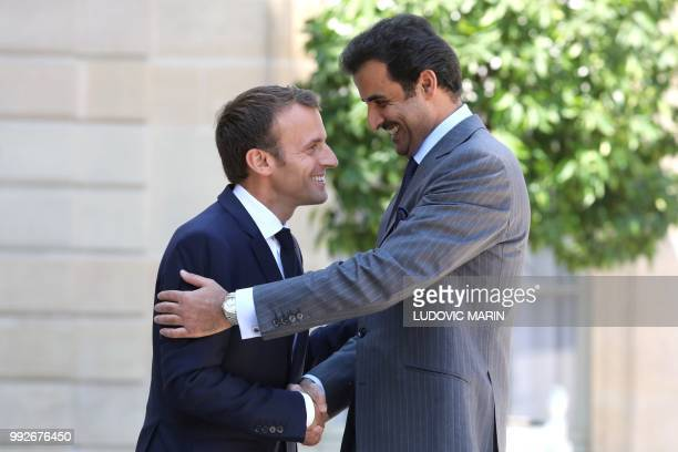 French President Emmanuel Macron welcomes Qatar Sheikh Tamim bin Hamad Al Thani arrives at the Elysee palace for a meeting with French president on...