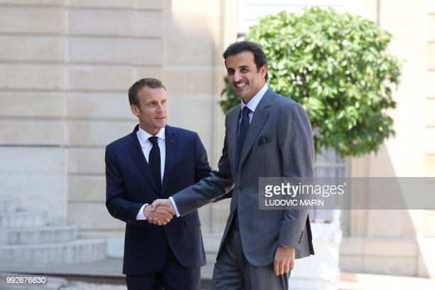 French President Emmanuel Macron welcomes Qatar Sheikh Tamim bin Hamad Al Thani arrives at the Elysee palace on July 6 in Paris