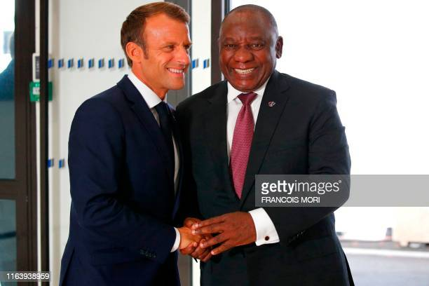 French President Emmanuel Macron welcomes South African President Cyril Ramaphosa, upon his arrival in Biarritz, south-west France on August 25 on...