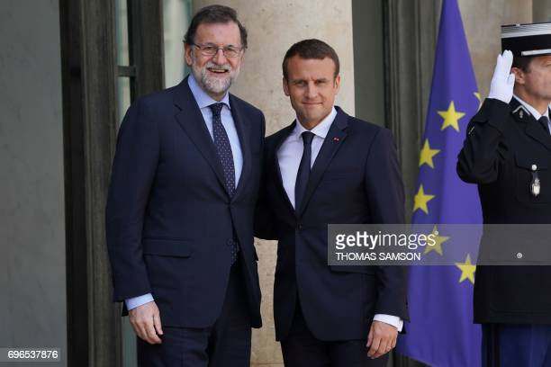French President Emmanuel Macron welcomes Spanish Prime Minister Mariano Rajoy for a working lunch at the Elysee Palace on June 16 2017 in Paris /...