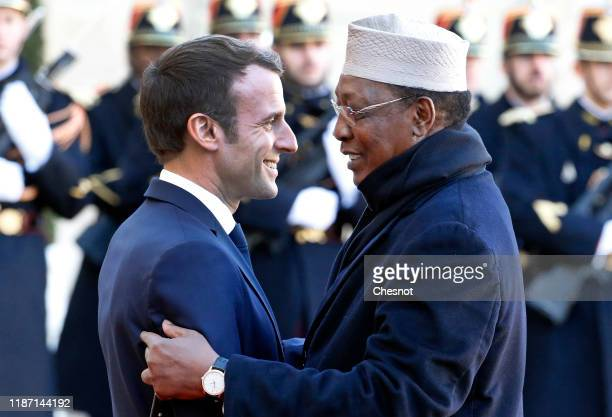 French President Emmanuel Macron welcomes Tchad's president Idriss Deby prior a lunch at the Elysee Presidential Palace on November 12 2019 in Paris...