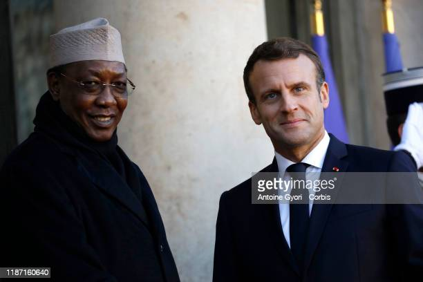 French President Emmanuel Macron welcomes Tchad's president Idriss Deby prior to a lunch at the Elysee Presidential Palace on November 12 2019 in...