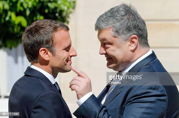 French President Emmanuel Macron welcomes Ukrainian President Petro Poroshenko prior to a meeting at the Elysee Presidential Palace on June 26 2017...