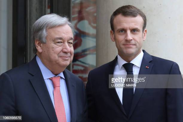 French President Emmanuel Macron welcomes UN general secretary Antonio Guterres upon his arrival at the Elysee presidential palace for a meeting on...