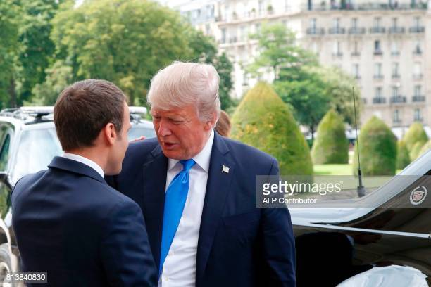 French President Emmanuel Macron welcomes US President Donald Trump outside the Army Museum during a ceremony at Les Invalides in Paris on July 13...