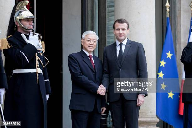 French President Emmanuel Macron welcomes Vietnamese Communist Party chief Nguyen Phu Trong at Elysee Palace on March 27 2018 in Paris France This is...